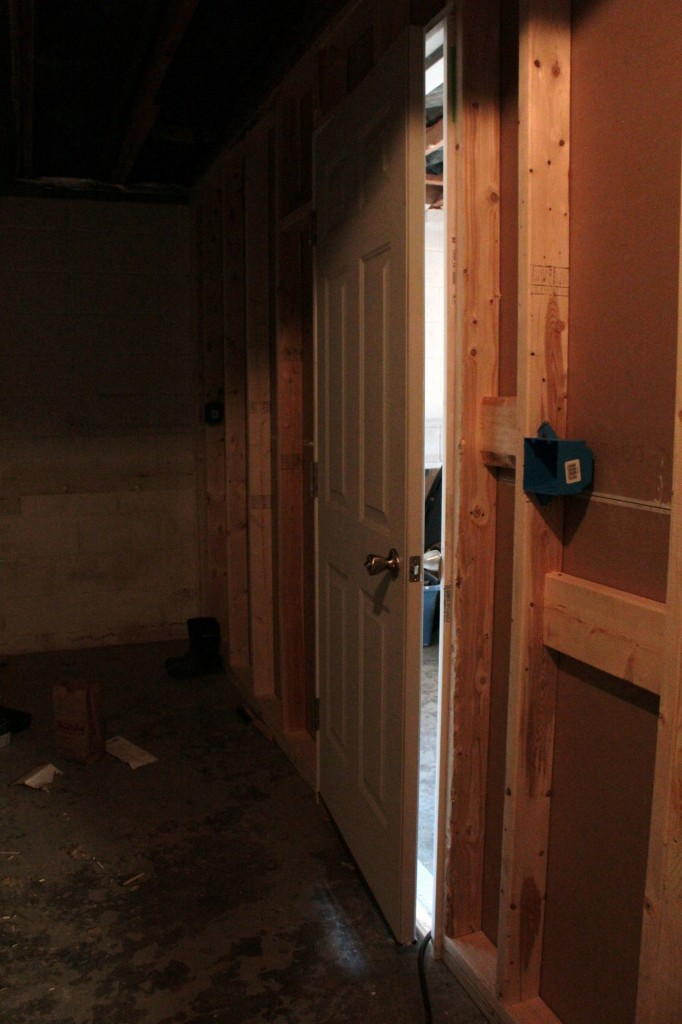 Looking from the foot of the basement stairs toward the new  garage wall
