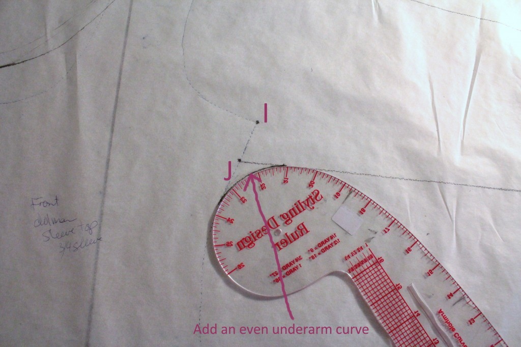 Add an even underarm curve from the sleeve to the side seam.