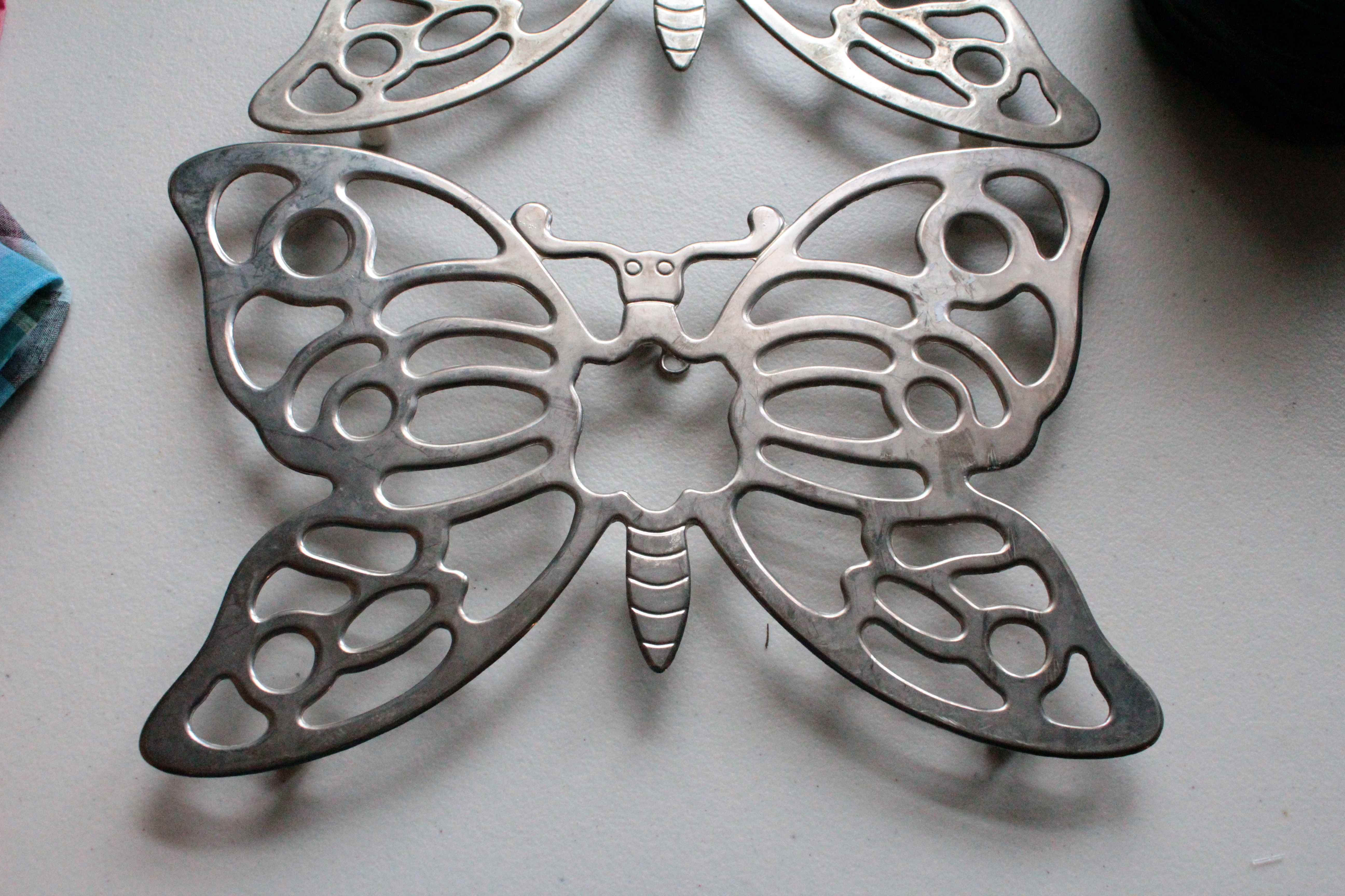 I found these two butterfly trivets in different sections of one thrift store. They're nice and heavy and absolutely adorable. I'm going to put them in the Alex's tumbler to polish them up a bit.