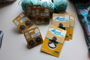 Minty green sport weight yarn, vintage shade pulls and curtain holdbacks.